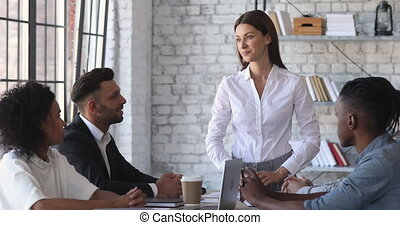 Female ceo discussing corporate project with business team ...