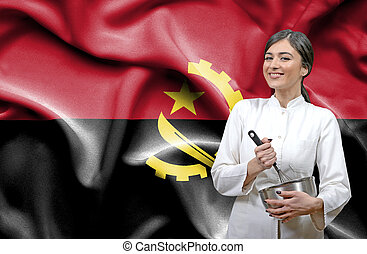 Female chef against national flag of Angola