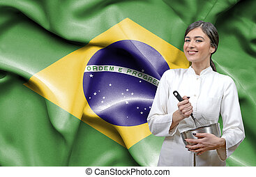 Female chef against national flag of Brazil