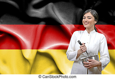 Female chef against national flag of Germany