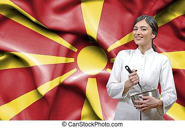 Female chef against national flag of Macedonia