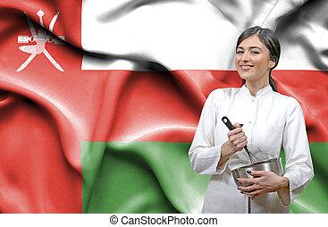 Female chef against national flag of Oman