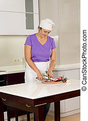 Female chef chopping fresh vegetables