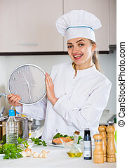 Female chef counting time down for cooling fish