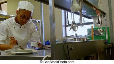 Female chef garnishing food on plate 4k - Female chef ...
