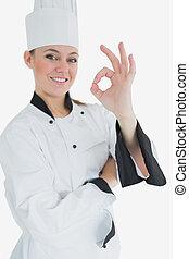 Female chef gesturing ok sign