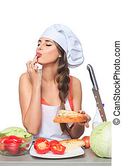 female chef holding a bread with expression