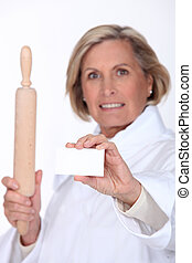 Female chef holding up a blank business card
