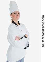 Female chef in uniform standing with arms crossed