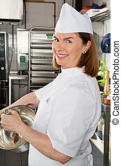 Female Chef Mixing Egg In Container