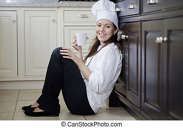 Female chef on a coffee break