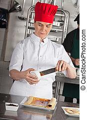 Female Chef Preparing Chocolate Roll