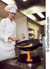 Female chef preparing food in kitchen