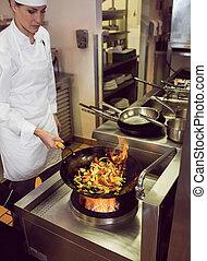 Female chef preparing food in kitchen