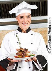 female chef presenting food