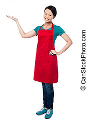 Cute female chef promoting bakery product