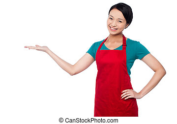 Female chef promoting bakery product