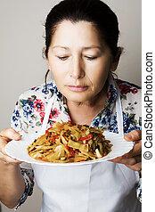 Female chef shows dish