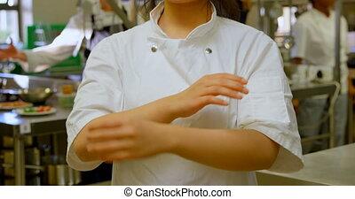 Female chef smiling in kitchen at restaurant 4k