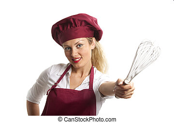 female chef with a beater