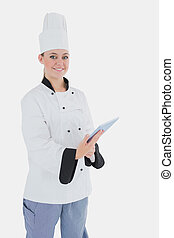 Female chef with digital tablet
