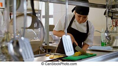 Female chef working in kitchen 4k