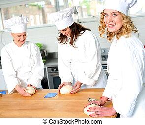 Female chefs at work in a restaurant kitchen