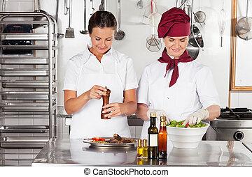 Female Chefs Preparing Food