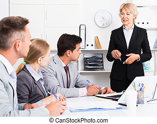 Female chief gathering managers for meeting