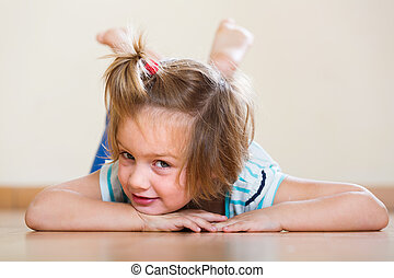 Female child laying at floor