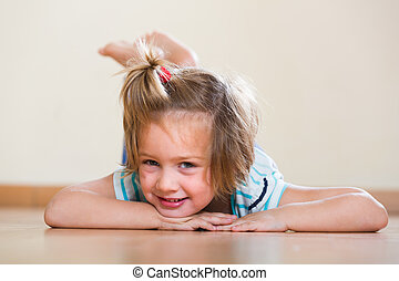 child laying at floor