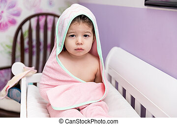 Female Child Resting In Crib After Bath