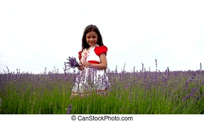 Female Child Standing in a Field of Lavender.