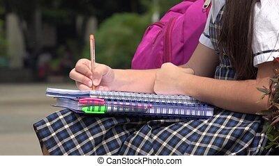 Female Child Student Writing