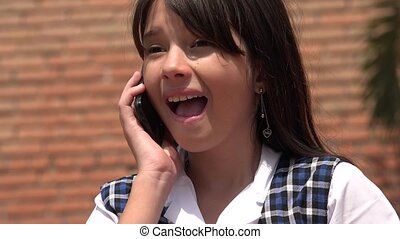 Female Child Talking On Cell