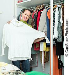 Female choosing apparel at store