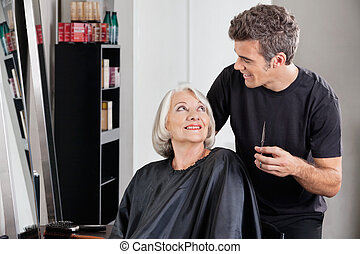 Female Client And Hairdresser Looking At Each Other