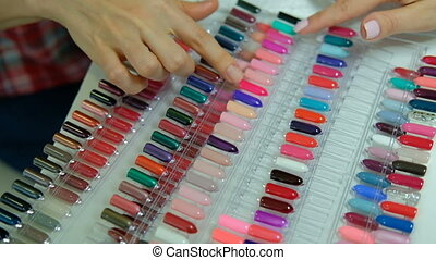Female client chooses a color from a large palette for...