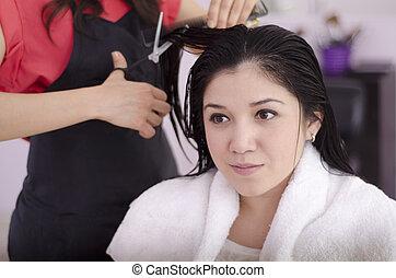 Female client getting a haircut