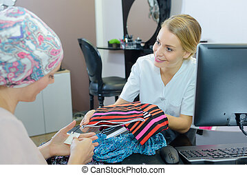 female client in beauty salon with a beautician