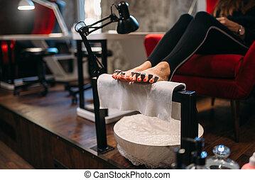Female client on pedicure procedure, beauty salon