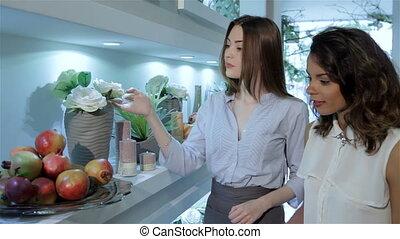Female client take the garnet from flower shelf
