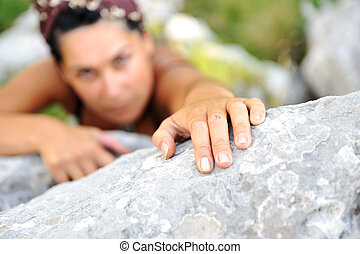 Female climbing the rock on mountain