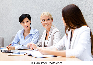 Female colleagues review business plan