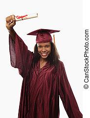 female college graduate in cap and gown