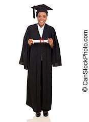 female college graduate in gown and cap