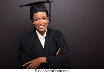 female college graduate with arms crossed