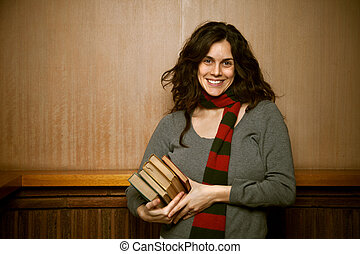 Female College Student with Books - A female college student...