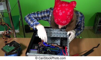 female computer repairer remove ram memory from desktop pc...