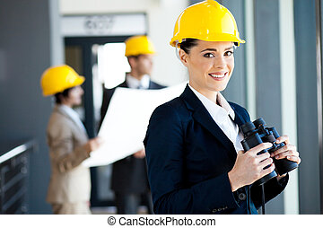 construction manager with binoculars